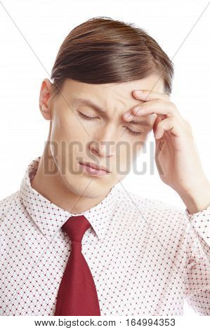 Businessman suffering from the headache and emotional stress