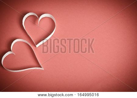 Hearts From White Paper Lying On A Red Background