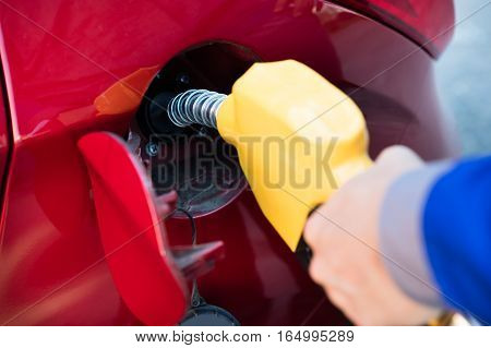 Mid Section Of Person Refueling Car's Tank