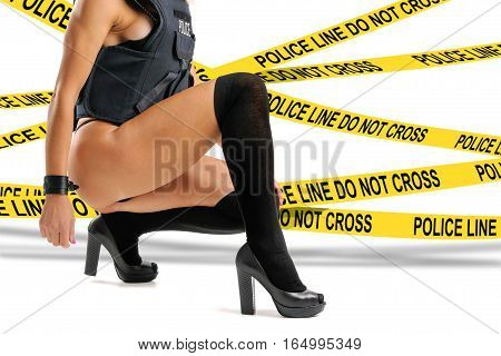 Sexy police woman with bulletproof vest isolated