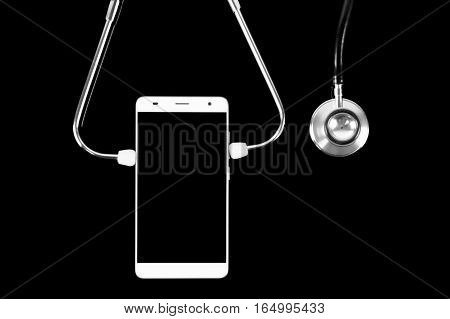 Medical Concept: Stethoscope and smartphone on black background