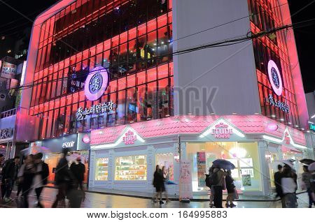 SEOUL SOUTH KOREA - OCTOBER 23, 2016: Unidentified people visit Hongdae shopping street. Hongdae is known for its urban arts and indie music culture, clubs and entertainments
