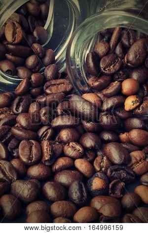 Strewn, arabica, graw coffee from two glasses.