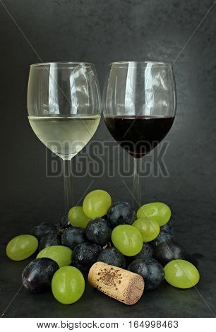 Red and white wine with colour grapes and cork.