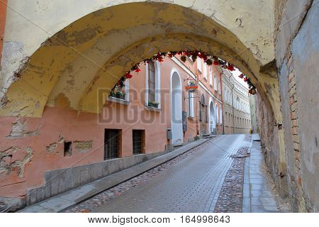 VILNIUS, LITHUANIA - JANUARY 2, 2017: Kazimiero street with an arcade in the foreground
