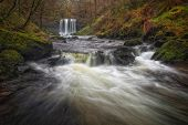 The Afon Hepste river plunging over a band of resistant gritstone to form the waterfall Sgwd yr Eira which translates into 'Fall of snow' and often refered to as the 'waterfall you can walk under'. poster