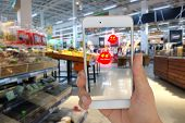 internet of things marketing concept ,the customer use the augmented reality to show the hot deal in the retail poster