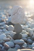 The balance among the chaos, a stone pyramid, unconventional solutions, round bright stones poster