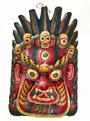 The mask for the Hindu god Mahakala has three eyes and five skulls. He is the consort for Kali and is considered to be a dharamapala or protector deity. poster