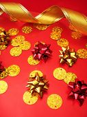 golden celebratory ribbon and bows on red background poster