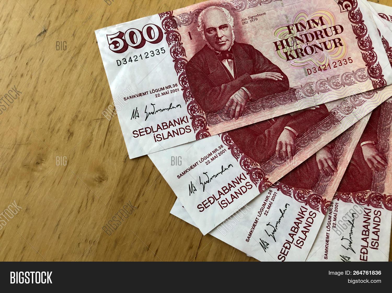 Icelandic Cash Money Of Iceland Several 500 Krona Bills On Wooden Table