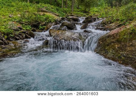 Wild River With Turquoise Water In Carpathian Mountains. Mountain Stream Flowing Into A Mountain Riv