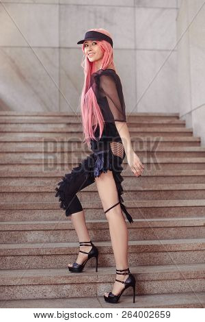 Japan Anime Cosplay. Colorful Portrait Of Young Attractive Asian Woman In Sexy Dress With Creative M