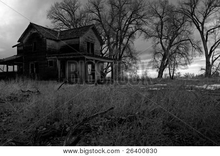 haunted house in rural Wyoming, HDR image processed and converted to monochrome with intentionally added grain for dark, moody look