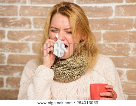 Girl In Scarf Hold Tea Mug And Tissue. Runny Nose And Other Symptoms Of Cold. Tips How To Get Rid Of