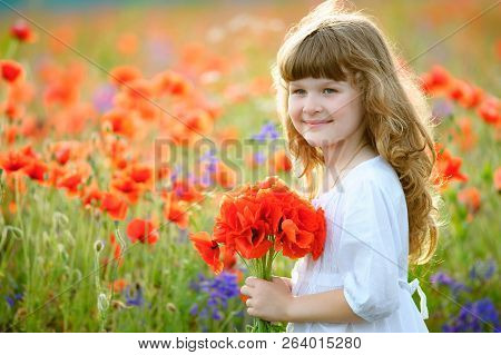 Adorable Little Girl With Wild Red Flowers Bouquet