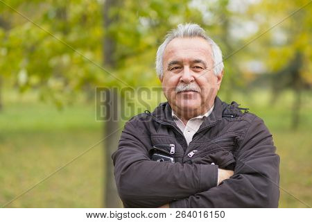 Portrait Of An Elderly Man In The Park.