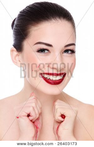 Portrait of young beautiful happy laughing woman squeezing pomegranates in her hands, over white background