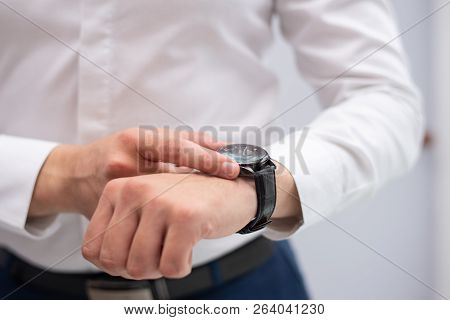 Close-up Of Businessman Looking At His Modern Wristwatch. Caucasian Manager Checking Time. Time And