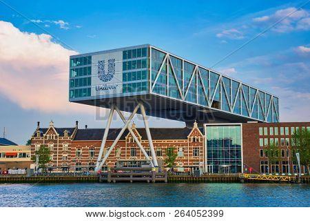 ROTTERDAM, NETHERLANDS - MAY 11, 2017: Unilever Bestfoods headquarters building De Brug (The Bridge) built over an existing historical factory from 1891 designed by architect Chris de Jonge