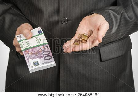 Man In A Suit Holds In One Hand A Wad Of Money In Denominations Of Five Hundred Euros And In The Oth