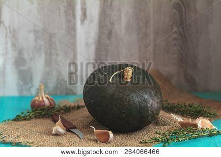 Green Pumpkin And Ingredients For Tasty Vegetarian Cooking