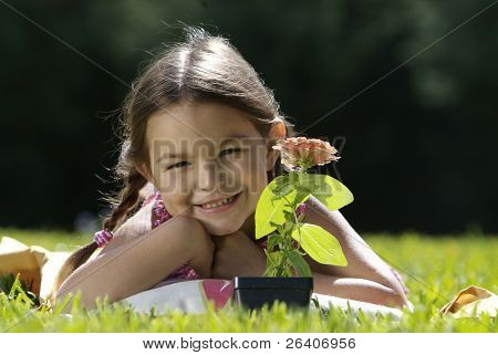 Girl in sun with flower 01