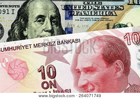 A Close Up Image Of A Blue American One Hundred Dollar Bill With A Ten Turkish Lira Bill