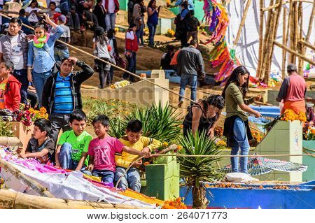 Santiago Sacatepequez, Guatemala - November 1, 2017: Locals & Tourists Amidst Giant Kites & Graves D