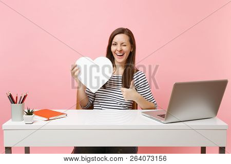 Funny Woman Blinking Showing Thumb Up Holding White Heart With Copy Space Working On Project While S