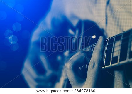 A Young Guy Playing Blues On An Electric Guitar. Close-up