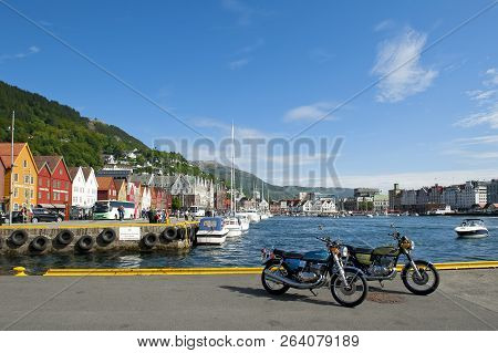 Bergen, Norway - July 15, 2018: Two Suzuki Motorcycles And Bryggen - The Hanseatic Commercial Buildi