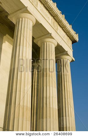 Beautiful sun lit building columns background texture with blue sky 07