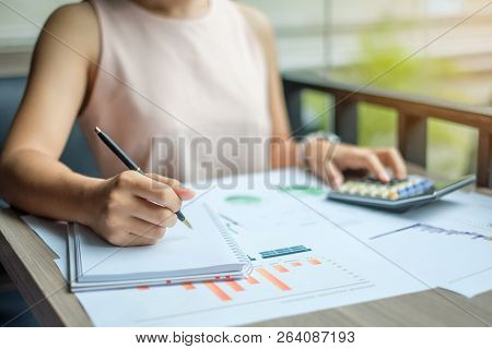 Businesswoman Analysis Maketing Plan, Accountant Calculate Financial Report, With Graph Chart.  Busi