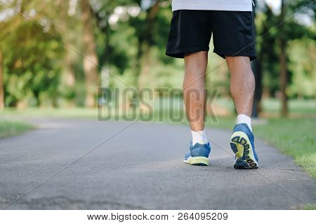 Young Fitness Man Legs Running In The Park Outdoor, Male Runner Walking On The Road Outside, Asian A