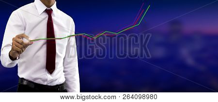 Young Businessman Study Of The Line Graph Of The Economic Growth Index On The 3d Screen.