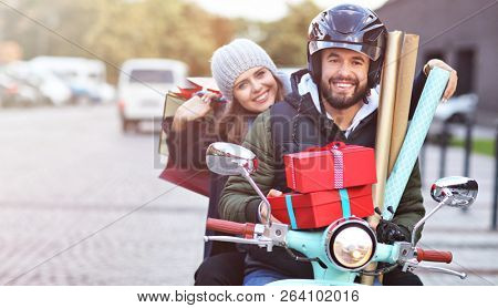 Portrait of happy couple with shopping bags after shopping in city