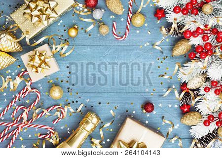 Christmas Background With Snowy Fir Tree, Gift Or Present Box, Champagne And Holiday Decorations On