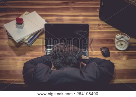 Businessman Sleeping Front Laptop Computer Tired From Work.