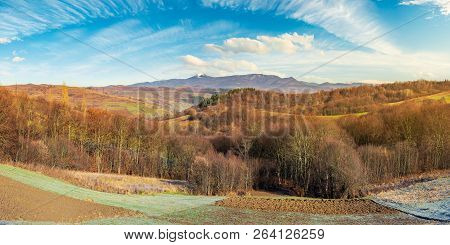Panorama Of Mountainous Countryside In Late Autumn. Almost Leafless Forest On Hill. Gorgeous Cloudsc