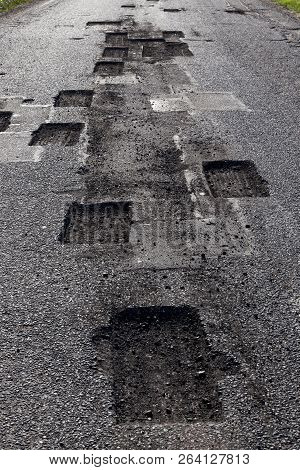 Sawed Square And Rectangular Openings On The Asphalt During Repairs, Restoration Of The Old Carriage