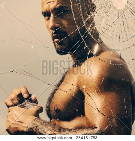 Parfume For Man. Brutal Handsome Man With Tattooed Body. Sexy Man With Muscular Body With Bare Torso