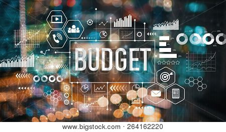 Budget With Blurred City Abstract Lights Background
