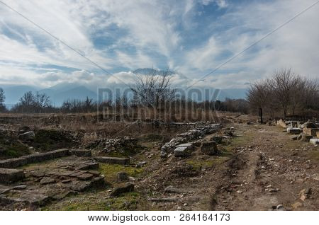 Ruins Of Building At Dion Archaeological Site With Olympus Mountain At Background. Pieria, Macedonia