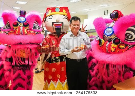 Chinese Business Manager Posing With Two Lions In Office After Dance Performance That Believe To Bri