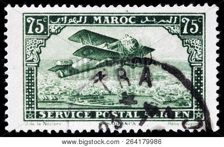 Luga, Russia - September 12, 2018: A Stamp Printed By Morocco Shows Biplane Over Casablanca - The La