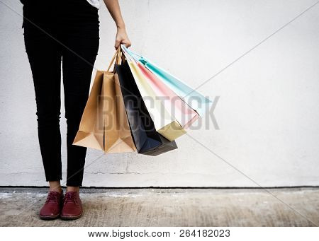 Shopping Bags Were Hlding By Woman Crazy Shopaholic Person At Shopping Mall.colorful Paper Shopping