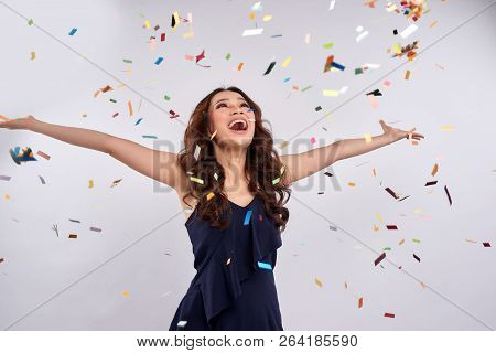 Beautiful Happy Woman At Celebration Party With Confetti Falling Everywhere On Her. Birthday Or New