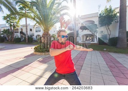 Holidays, Christmas And People Concept - Man In Deer Horns And Glasses Dancing And Smilng.