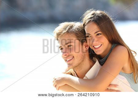 Happy Couple Of Teens In Love Flirting On The Beach